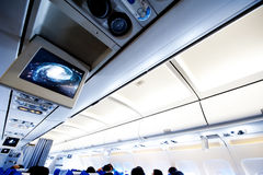 Aircraft cabin. Interior of aircraft cabin with passenger Stock Photo