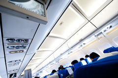 Aircraft cabin. Interior of aircraft cabin with passenger Stock Images
