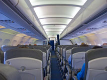 Aircraft cabin. After take off Stock Images