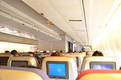 Aircraft cabin interior with passengers Royalty Free Stock Photography