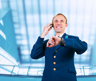 Aircraft captain portrait in airport Stock Photos
