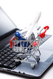 Aircraft and car in shopping trolley Royalty Free Stock Image