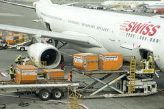 Aircraft cargo handling Loading containers Stock Photos