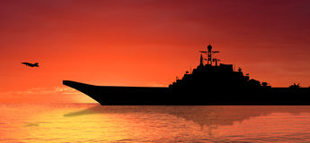 Aircraft carrier. On sea at sunset royalty free stock photo