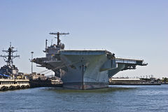 Aircraft Carrier. US Navy aircraft carrier docked in Norfolk, Virginia. The largest and mightiest of all naval ships stock photography