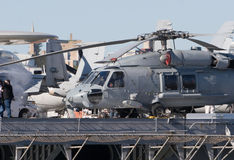 Aircraft Carrier. A navy helicopter on the deck of an aircraft carrier stock image
