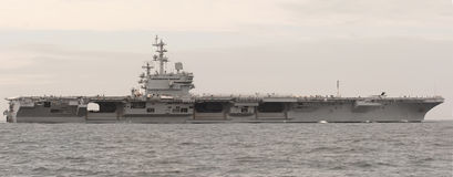 Aircraft Carrier. An Aircraft carrier at sea royalty free stock photos