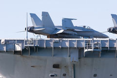 Aircraft Carrier. A navy jet fighter on the deck of an aircraft carrier stock photos
