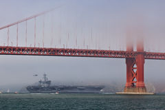 Aircraft carrier Carl Vinson Golden Gate Bridge Royalty Free Stock Photography
