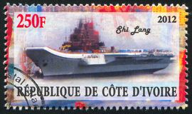 Aircraft carrier. IVORY COAST CIRCA 2012: stamp printed by Ivory Coast, shows aircraft carrier, circa 2012 stock image