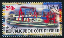 Aircraft carrier. IVORY COAST CIRCA 2012: stamp printed by Ivory Coast, shows aircraft carrier, circa 2012 stock photography