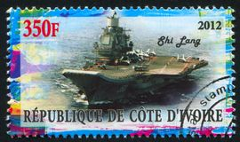 Aircraft carrier. IVORY COAST CIRCA 2012: stamp printed by Ivory Coast, shows aircraft carrier, circa 2012 stock photos