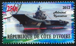 Aircraft carrier. IVORY COAST CIRCA 2012: stamp printed by Ivory Coast, shows aircraft carrier, circa 2012 royalty free stock photography