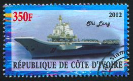 Aircraft carrier. IVORY COAST CIRCA 2012: stamp printed by Ivory Coast, shows aircraft carrier, circa 2012 stock photo