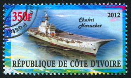 Aircraft carrier. IVORY COAST CIRCA 2012: stamp printed by Ivory Coast, shows aircraft carrier, circa 2012 royalty free stock image
