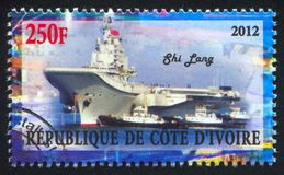 Aircraft carrier. IVORY COAST CIRCA 2012: stamp printed by Ivory Coast, shows aircraft carrier, circa 2012 stock images