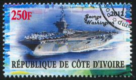 Aircraft carrier. IVORY COAST CIRCA 2012: stamp printed by Ivory Coast, shows aircraft carrier, circa 2012 royalty free stock images