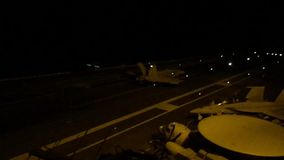 Aircraft Carrier. A jet landing on the deck of an aircraft carrier off the coast of Florida stock footage