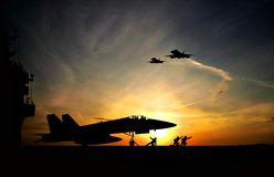 Aircraft carrier. Military aircraft before take-off from aircraft carrier on dramatic sunset background stock photo