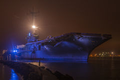 Aircraft carrier at night Stock Images