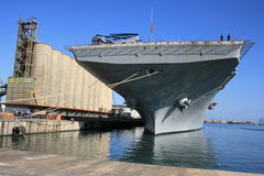 Aircraft carrier at port Stock Photos