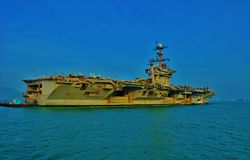Aircraft Carrier. An aircraft carrier is a warship with a full-length flight deck and facilities for carrying, arming, deploying, and recovering aircraft, that Stock Images