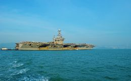 Aircraft Carrier. An aircraft carrier is a warship with a full-length flight deck and facilities for carrying, arming, deploying, and recovering aircraft, that Stock Photo