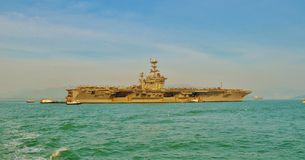 Aircraft Carrier. An aircraft carrier is a warship with a full-length flight deck and facilities for carrying, arming, deploying, and recovering aircraft, that Stock Image
