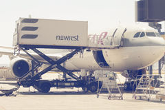 Aircraft catering vehicle serving 2. ATHEN, GREECE - JULY 24, 2016: Aircraft catering vehicle serving Qatar aircraft. Airline catering, flying food Royalty Free Stock Photography
