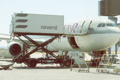 Aircraft catering vehicle serving 3. ATHEN, GREECE - JULY 24, 2016: Aircraft catering vehicle serving Qatar aircraft. Airline catering, flying food Royalty Free Stock Photography
