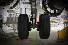 Aircraft chassis. Repairing in hangar Stock Images