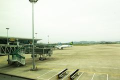 Aircraft and chinese people prepare to take off and landing at Jieyang Chaoshan International Airport at Shantou, China stock photography
