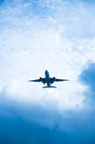 Aircraft in a clouded sky Royalty Free Stock Photo