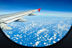 Aircraft and clouds Stock Photography