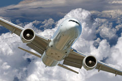 Aircraft in the clouds Stock Photography