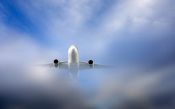 Aircraft in clouds Stock Photo
