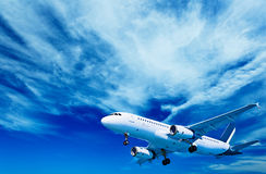 Aircraft on a cloudy sky background Stock Photography
