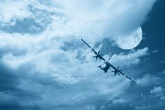 Aircraft in the cloudy sky Stock Images