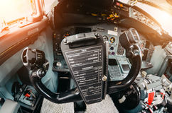 Aircraft cockpit handwheel view on the control panel. Stock Images