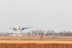 Aircraft coming in to land at Schipol Airport. Aircraft coming in to land on the runway at Schipol Airport in Holland with the wheels and undercarriage extended royalty free stock image