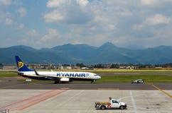 Aircraft companies Rayanair flies up at the airport of Bergamo. Stock Photos