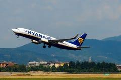 Aircraft companies Rayanair flies up at the airport of Bergamo. Stock Images