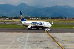 Aircraft companies Rayanair flies up at the airport of Bergamo. Stock Images