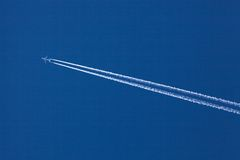 Aircraft and contrails Royalty Free Stock Photography