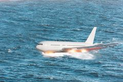 Aircraft crash falling into the sea, an explosion engine hit by splashing on the water.  stock images