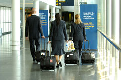 Aircraft crew. Walking along the floor at the airport hall to the departure stock photos