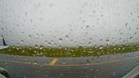 The aircraft is delayed in the runway due to a severe thunderstorm Boston Logan International airport during the rain