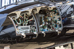 Aircraft electronics. Avionics bay in the nose of a black aircraft, with components, cables and circuit breakers royalty free stock photography
