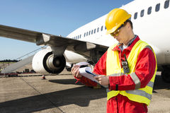 Aircraft engineer. With a checklist of several pages on a clipboard Stock Photos