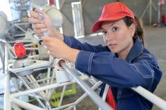 Aircraft engineer looking at camera. Aircraft engineer looking at the camera royalty free stock photo